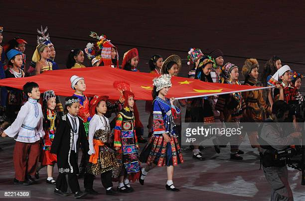 Children parade with the Chinese national flag during the 2008 Beijing Olympic Games opening ceremony on August 8 2008 at the National Stadium in...