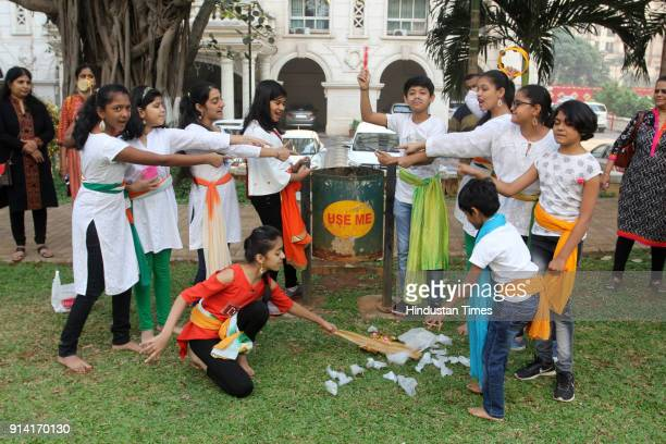 Children participate in a campaign to spread the message of Swacha Bharat through street play at Hiranandani Midows on February 3 2018 in Mumbai...