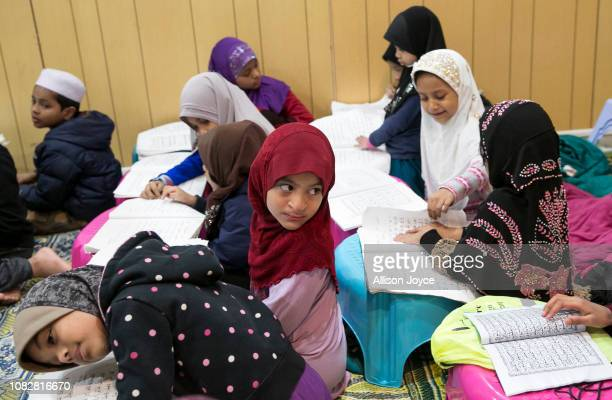 Children participate in a Koran class at the Rohingya Cultural Center of Chicago on January 10 2019 in Chicago Illinois Chicago has one of the...