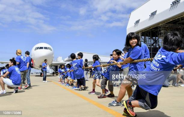 Children participate in a plane pull event at Narita airport near Tokyo on Sept 23 2018 ==Kyodo