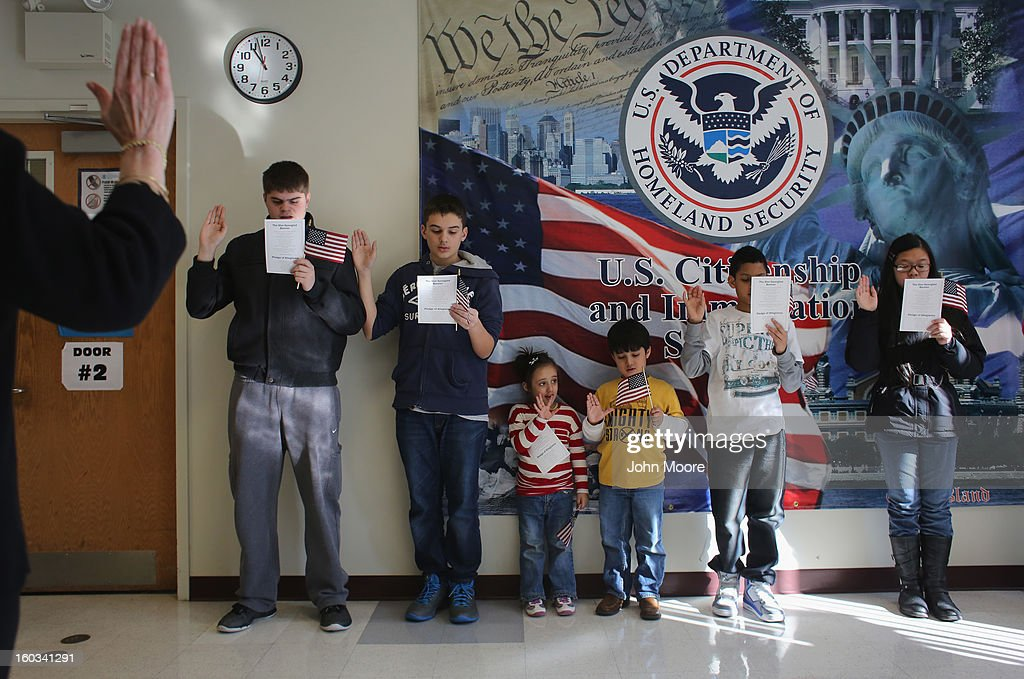 Children participate in a U.S. citizenship ceremony at the U.S. Citizenship and Immigration Services (USCIS), district office on January 29, 2013 in New York City. Some 118,000 immigrants applied for U.S. citizenship and 2,500 children received citizenship certificates in the New York City dictrict in 2012. Although underage children of naturalized immigrants usually receive U.S. citizenship, they must go through a process at the USCIS in order to receive legal certificates. Children born in the United States are American, regardless of the immigrant status of their parents.