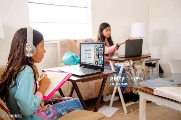children participate in e-learning activity at home - homeschool stock pictures, royalty-free photos & images