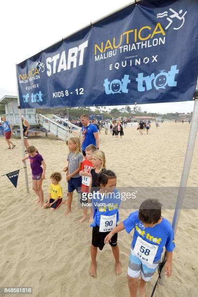 Children participate in the 'Tot Trot' during the Nautica Malibu Triathlon at Zuma Beach on September 17 2017 in Malibu California