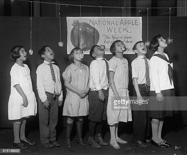 Children participating in apple competition during National Apple Week New York City New York State USA October 30 1925