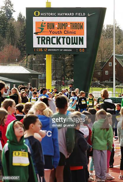 children participating in track & field youth clinic - eugene oregon stock photos and pictures