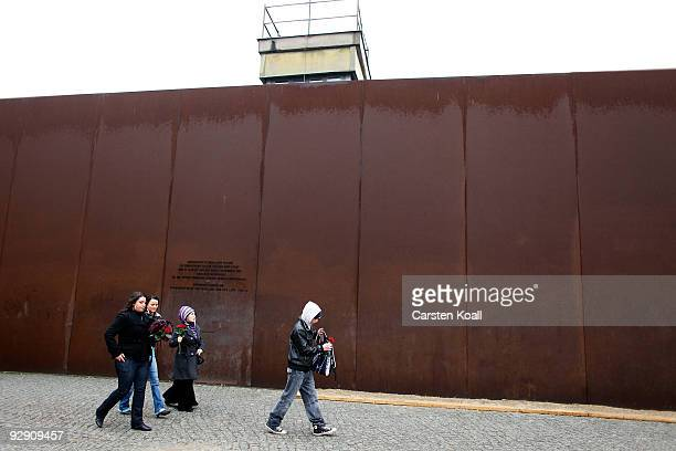 Children pass a stillexisting section of the Berlin Wall at West Berlin at the Bernauer Strasse memorial on the 20th anniversary of the fall of the...