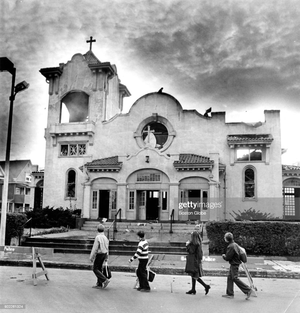 Children pass by the remains of St. William's Church, gutted by an eight-alarm fire, in the Dorchester neighborhood of Boston on Sep. 24, 1980.