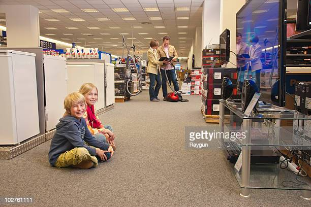 Children passing time by watching TV