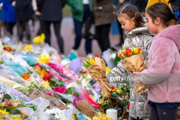 Children pay their respects to Sarah Everard at the bandstand, Clapham Common, where floral tributes have been building up over the last few days on...