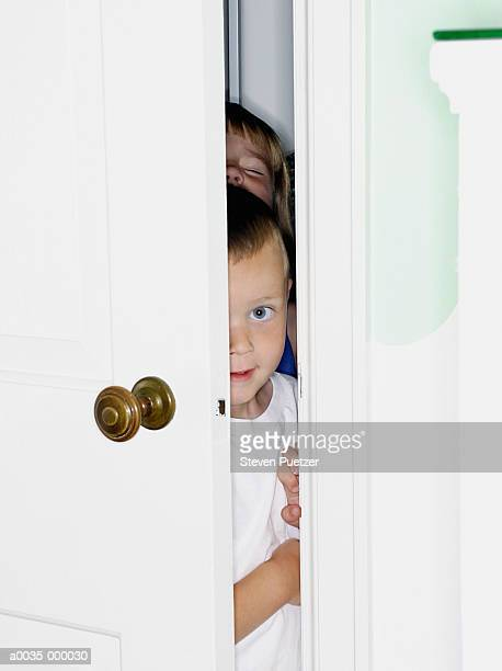 children peaking through door - ajar stock pictures, royalty-free photos & images