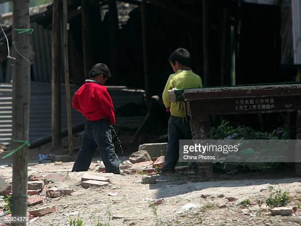 Children pee at a rural street of a village on April 29 2008 in the outskirts of Fuyang of Anhui Province east China The lethal intestinal virus has...