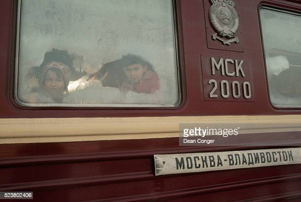Children Peer Through the Frosted Window of a Trans-Siberian Railway Car