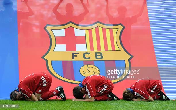 Children peformance in front of a FC Barcelona banner prior to the Audi Cup football match FC Barcelona vs SC International de Porto Alegre in Munich...