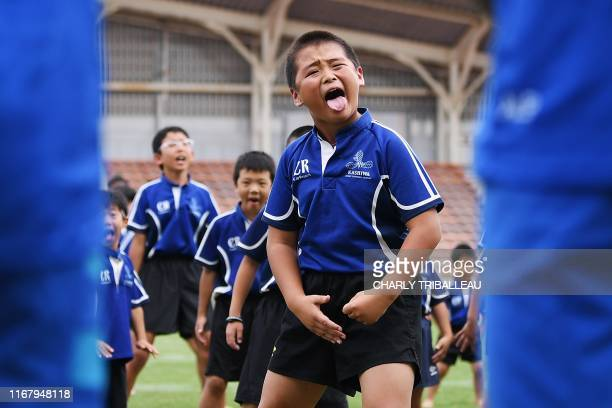 TOPSHOT Children perform a haka in front of New Zealand's players during a fans event at Kashiwanoha Park Stadium in Kashiwa Chiba prefecture on...