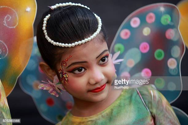 Children perform a traditional dance wearing butterfly dress during the quotBasanta Utsabquot or spring Festival in Dhaka on February 13 2015...