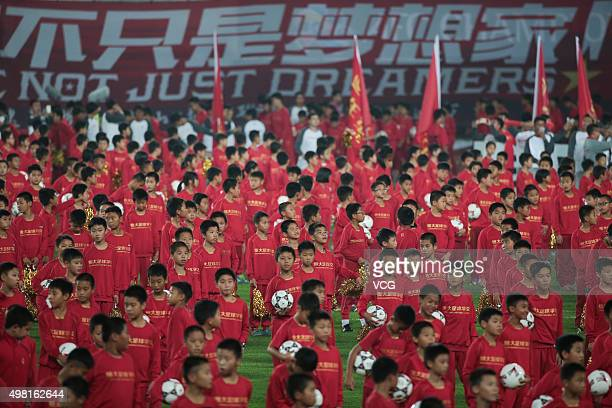 Children perform after Guangzhou Evergrande won the second leg of the AFC Champions League final match between Guangzhou Evergrande and Al Ahli at...