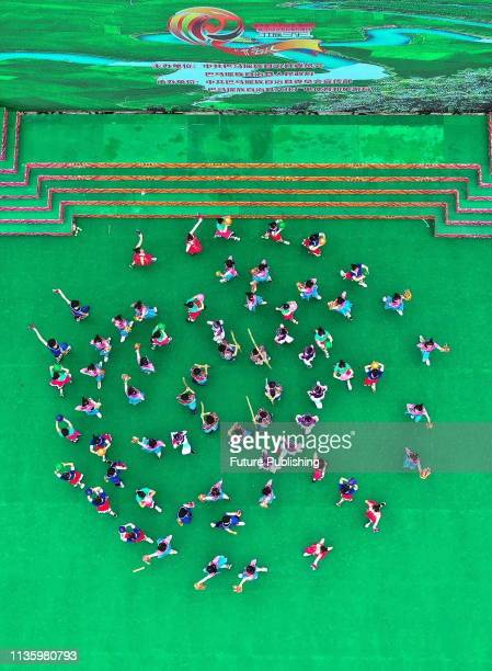 Children perform folk songs and dances at a stadium in bama county, south China's guangxi zhuang autonomous region, April 7, 2019. PHOTOGRAPH BY...