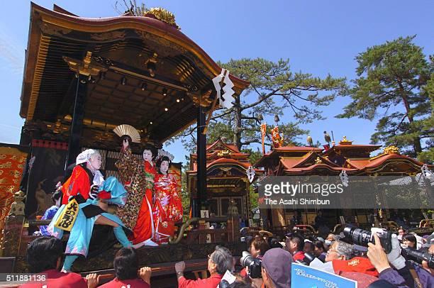 Children perform Kabuki on stage of the 'Hikiyama' floats during the Nagahama Hikiyama Festival at the Nagahama Hachimangu Shrineon April 15 2004 in...