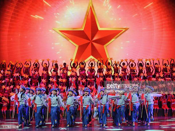 Children perform on stage singing 'red songs' to mark the 90th Anniversary Of The Communist Party Of China on June 29 2011 in Chengdu Suchuan...