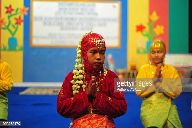 children performing a traditional dance in tradiional dress at SOS Children's Village facility Banda Aceh Sumatra Indonesia
