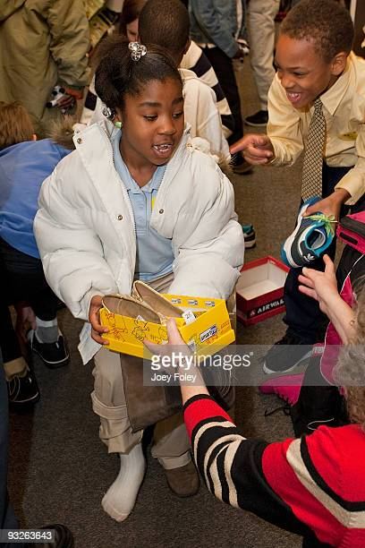 Children pick out new pairs of shoes and try them on at Payless ShoeSource on November 20 2009 in Cincinnati Ohio
