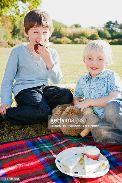 Children picnicking with teddy bears