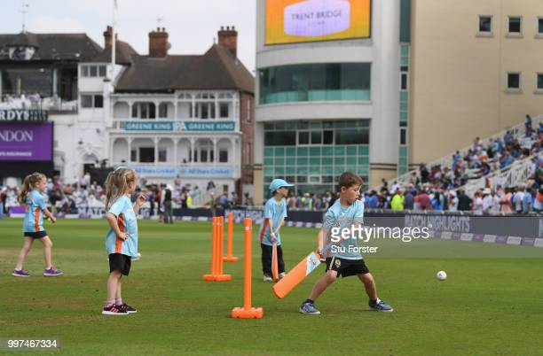 Children pictured playing All Stars Cricket during the 1st Royal London One Day International match between England and India at Trent Bridge on July...