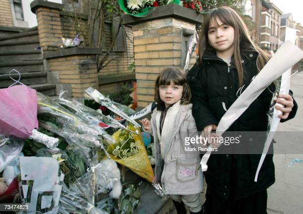 Children place flowers at the entrance of the house of the Mokadem family at the General Jaques Avenue March 2 2007 in Nivelles Belgium The Belgian...