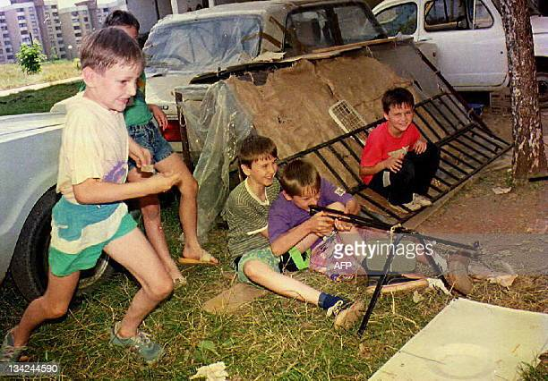 Children play 01 August 1992 in the Alipasino Polje area of the besieged Bosnian capital Sarajevo The situation was relatively calm in the city...