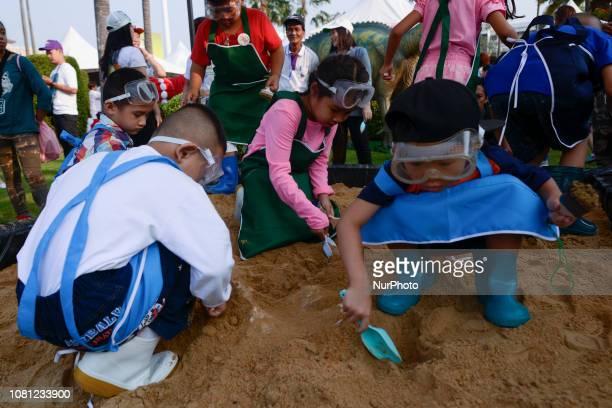 Children play a dinosaur figure model during Children's Day in Bangkok Thailand 12 January 2019