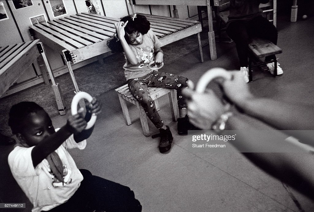 children play a game in class to inmprove their posture the peto