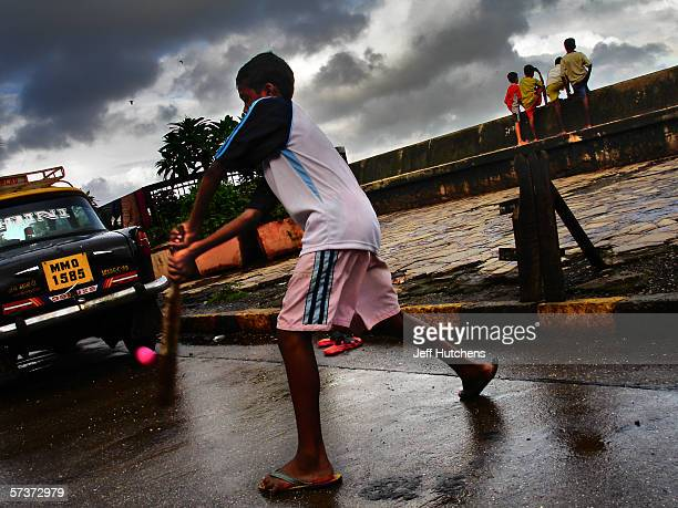 Children play a game of cricket in the streets on September 10 2005 in Mumbai India Emerging from one of the most deadly monsoon seasons in recent...