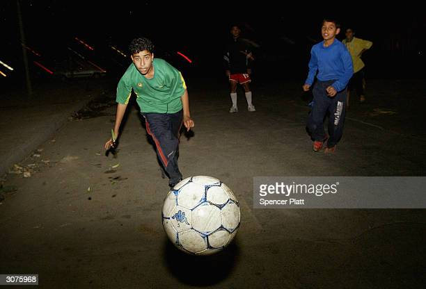 Children play a game of evening soccer March 11 2004 in Baghdad Iraq Despite the continuing daily violence in Iraq much of the country is slowing...
