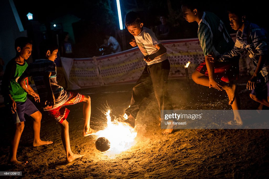 Children play a game of fire football, known as 'bola api', a coconut is soaked in kerosene and set on fire during celebrations of Indonesia's National Independence Day on August 15, 2015 in Yogyakarta, Indonesia. Indonesia became an independent nation on August 17, 1945 having previously been under Dutch rule.