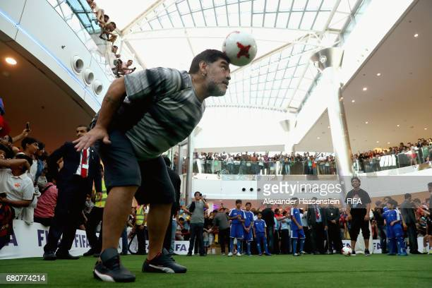 Children play a game of football with FIFA Legend Diego Maradona of Argentina during a grass roots football training session at the Seef Mall...