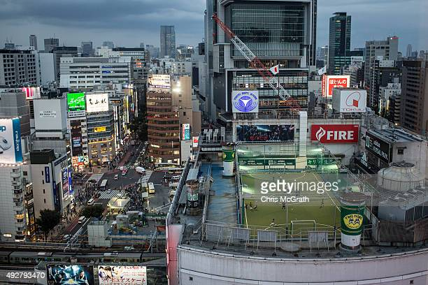 Children play a game of soccer on a rooftop overlooking the Shibuya district on October 15 2015 in Tokyo Japan
