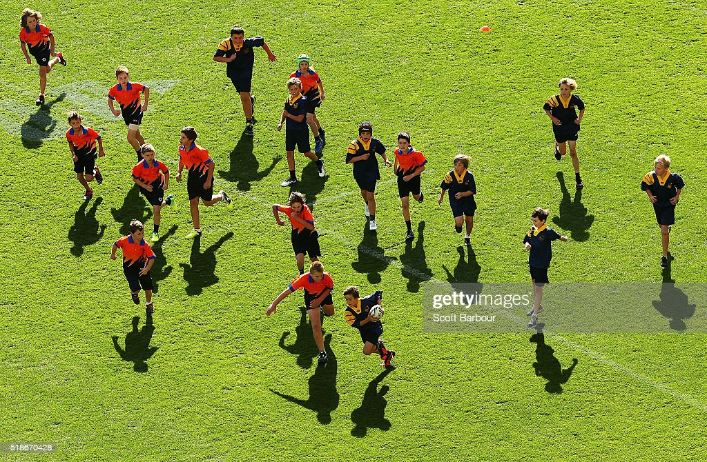Children play a game of touch football during the half time break of the round five NRL match between the Melbourne Storm and the Newcastle Knights at AAMI Park on April 2, 2016 in Melbourne, Australia.