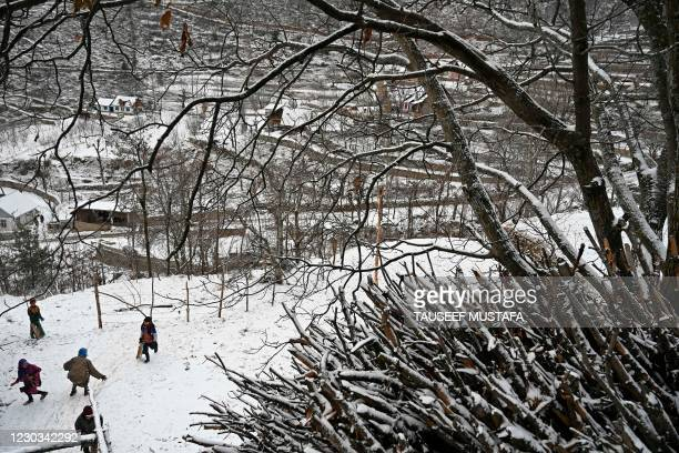 Children play after snowfall on the outskirts of Srinagar on December 29, 2020.