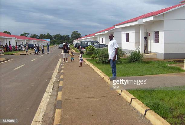 Children play along a street in the neighbourhood of Buena Esperanza in Malabo the capital of Equatorial Guinea on June 15 two days before the trial...