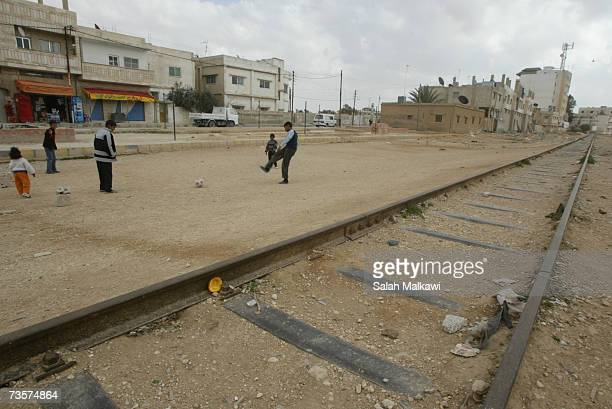 Children play along disused parts of the Hejaz Railway on March 14 2007 in Mafraq Jordan The railway is part of a broad regional collaboration...