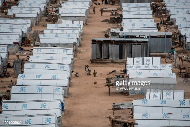 Children play amongst temporary shelters erected by the IOM in one of the IDP camps in Pulka on August 1 2018 As the presidential race heats up ahead...