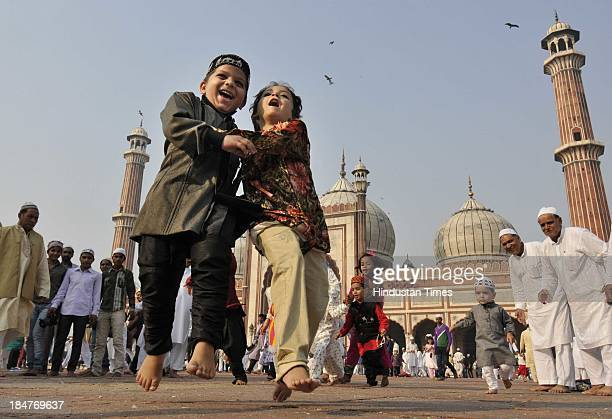 Children play and enjoy after the namaz on the occasion of Eid al-Adha at Jama Masjid on October 16, 2013 in New Delhi, India. Muslims around the...