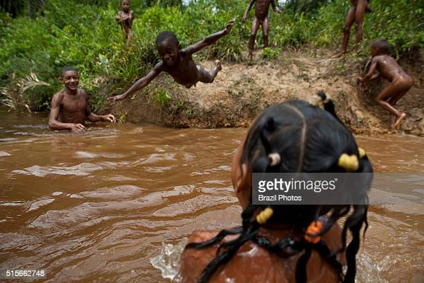 Children play and have fun in the river at Sao Raimundo Quilombo in Alcantara Maranhão State Northeastern Brazil A quilombo is a Brazilian hinterland...