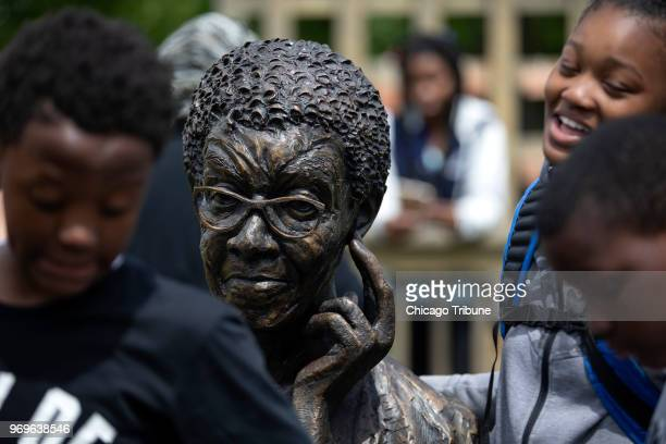 Children play around a new statue of poet Gwendolyn Brooks sculpted by Margot McMahon at Gwendolyn Brooks Park Wednesday June 6 in Chicago Ill