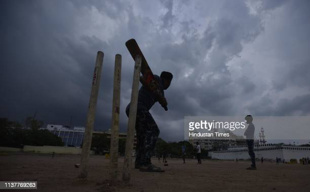 Children play as clouds hover over Ramilia Ground on April 17 2019 in New Delhi India Strong winds accompanied by light rain lashed the Capital in...