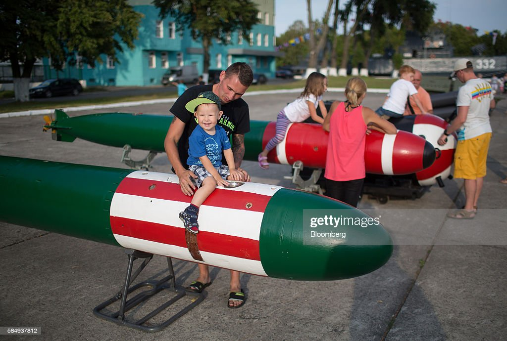Children play at a display of naval torpedoes during Russian Navy day at the Vistula lagoon in Baltiysk, Russia, on Sunday, July 31, 2016. Amid Russia's recent rearmament, the Kaliningrad region has increasingly returned to its Soviet-era role as a garrison on the strategic Baltic Sea coast. Photographer: Andrey Rudakov/Bloomberg via Getty Images