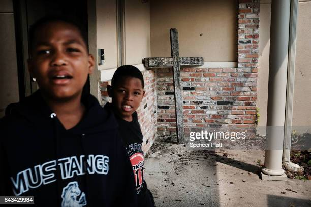 Children play at a flooded church that is now a relief center in Orange as Texas slowly moves toward recovery from the devastation of Hurricane...