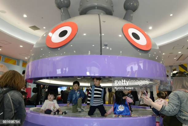 Children play at a new amusement facility based on anime character Baikinman in Kobe western Japan on March 14 2018 The facility was unveiled to the...