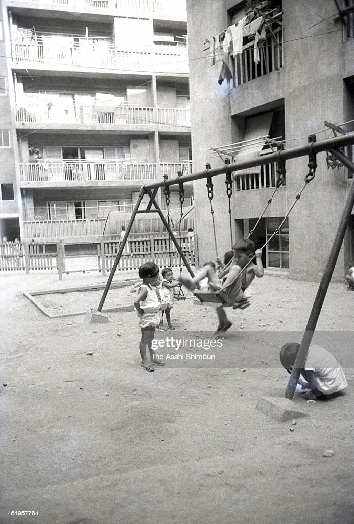Children play at a park at the Hashima on August 12, 1956 in Takashima, Nagasaki, Japan. The coal mining island, is also known as the Battleship Island, whose population used to be more than 5,000 in its heyday in 1959. In the residential area there were the Japan's first concrete building apartments.