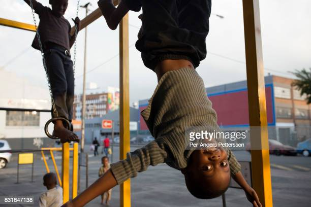 Children play at a playground outside a newly refurbished apartment building in Maboneng district on March 15 2016 in downtown Johannesburg South...